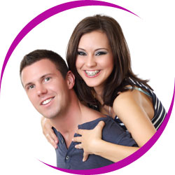 Young couple with healthy teeth smiling