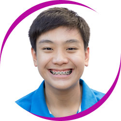 Young boy smiling wearing braces
