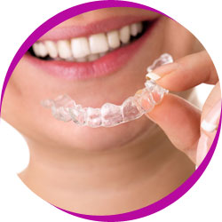 Lady using dental retainer
